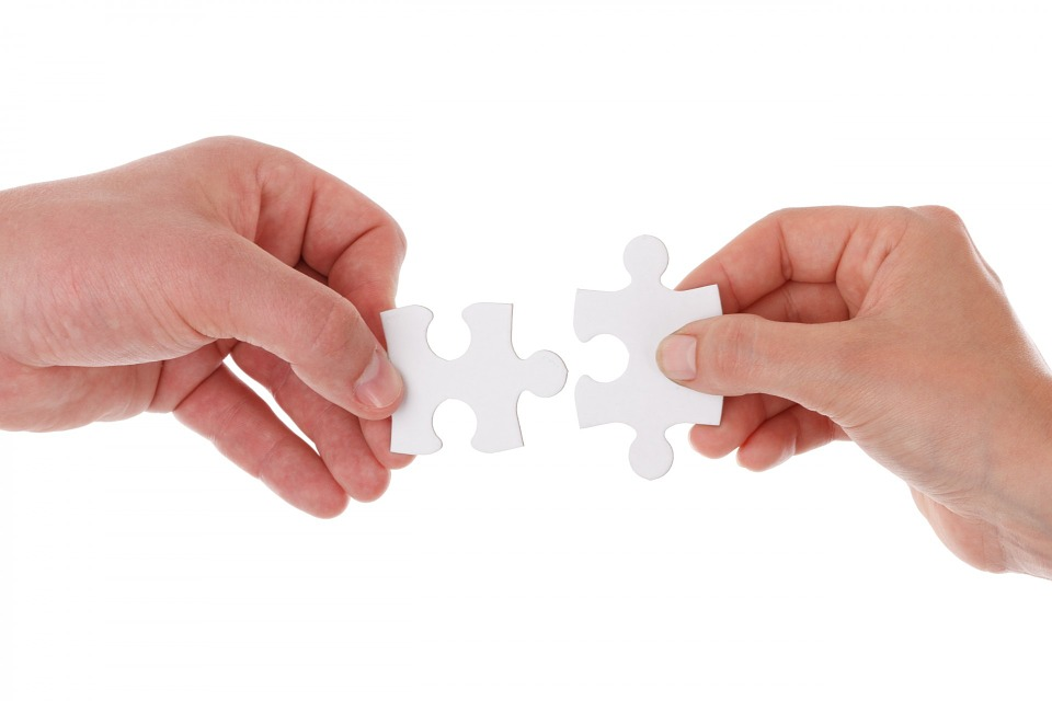 Person completing jigsaw